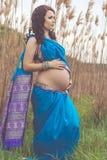 Pregnant girl is wearing fashion blue indian sari Royalty Free Stock Photo