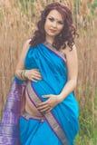 Pregnant girl is wearing fashion blue indian sari Stock Image