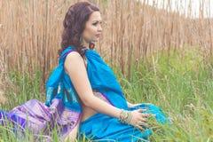 Pregnant girl is wearing fashion indian sari Royalty Free Stock Photo