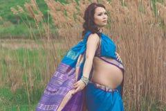 Pregnant girl is wearing indian sari Royalty Free Stock Photos