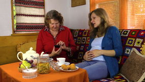 Pregnant granddaughter woman have fun with grandmother and phone stock video footage