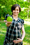 Pregnant with green apple Stock Photos