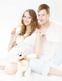 Pregnant happy smiling woman with husband Stock Photo