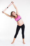 Pregnant happy woman doing yoga with rubber band Royalty Free Stock Photos