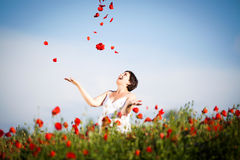 Pregnant happy woman in a flowering poppy field Royalty Free Stock Photo