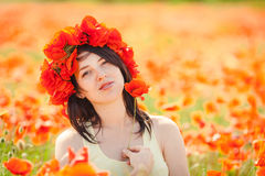 Pregnant happy woman in a flowering poppy field outdoors Stock Photography