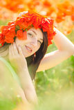 Pregnant happy woman in a flowering poppy field outdoors Royalty Free Stock Photo