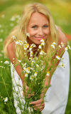 Pregnant happy woman in a flowering poppy field outdoors Royalty Free Stock Images