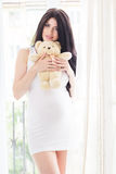 Pregnant happy woman is holding teddy bear Royalty Free Stock Photos