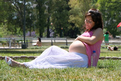Pregnant happy young woman Stock Image