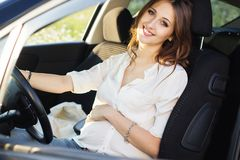 Pregnant happy young woman at the wheel of her car Royalty Free Stock Photo