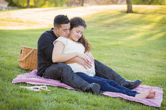 Pregnant Hispanic Couple in The Park Outdoors Stock Images