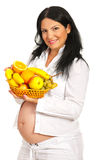 Pregnant holding  full basket with fruits Stock Image