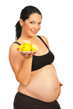 Pregnant holding plate with lemons Stock Photography