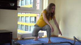 Pregnant house keeper wife woman hoover room with vacuum cleaner stock video