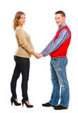 Pregnant with husband holding each others hands Royalty Free Stock Image