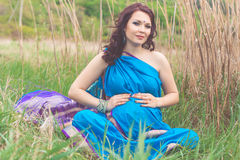 Pregnant indian girl is wearing blue fashion sari Stock Photography