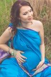 Pregnant indian girl is wearing blue sari Stock Photos