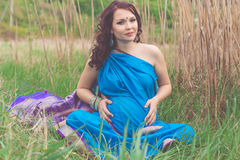 Pregnant indian girl is wearing blue sari Stock Images