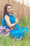 Pregnant indian girl is wearing blue sari Royalty Free Stock Photos