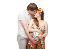 Pregnant kissing young couple Royalty Free Stock Photo