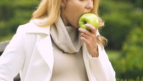 Pregnant lady with big belly feeling sick after biting apple suffering toxicosis. Stock footage stock footage