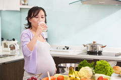 Pregnant lady drinking milk Stock Photography