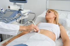 The pregnant lady pacient at ultrasonography examination. Close view, ultrasound, doctor, young, health, early, clinic, care, birth, scan, ultrasonic, medical royalty free stock photos