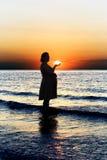 Pregnant lady on sunset Stock Photo