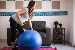 Pregnant and lifting weights Royalty Free Stock Photography