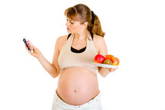Pregnant  making choice between drugs and fruits Royalty Free Stock Photo