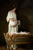 Pregnant Mary in front of Manger Royalty Free Stock Photography