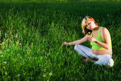 Pregnant on meadow Stock Photo