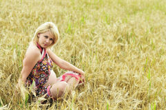 Pregnant meditation. Pregnant woman doing meditation in wheat field Royalty Free Stock Photography
