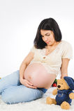 Pregnant Model with Bear Royalty Free Stock Images