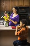 Pregnant mom arranging flowers Royalty Free Stock Photography