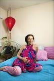 Pregnant mom in bedroom. Stock Image