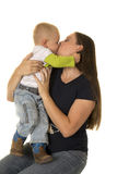 Pregnant mom with boy standing on lap kiss Stock Photos