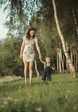 Pregnant mom walking with child Royalty Free Stock Images
