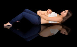 Pregnant mother with baby Stock Images