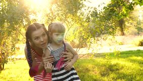 Pregnant mother and little daughter stock footage