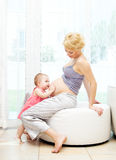 Pregnant mother and baby girl Royalty Free Stock Photos