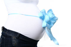 Pregnant mother with a blue bow Stock Photo