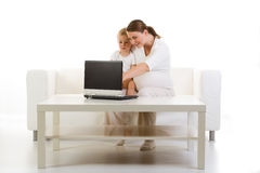 Pregnant mother and child using PC Royalty Free Stock Photography