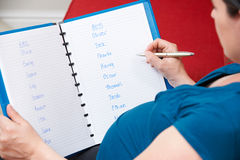 Pregnant Mother Choosing Name For Unborn Baby Royalty Free Stock Image