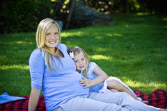 Pregnant Mother and Daughter Royalty Free Stock Photo