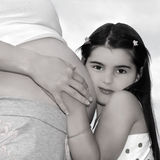 Pregnant Mother and Daughter Stock Images