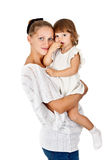 Pregnant mother and daughter to eat a plum Stock Photography