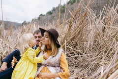 Pregnant mother, father and little daughter enjoying life outdoor Stock Images