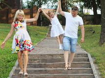 Pregnant mother, father, little daughter walk stock image